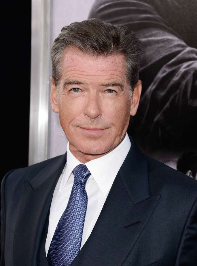"""Actor Pierce Brosnan attends the premiere of the feature film """"The November Man"""" at TCL Chinese Theatre on Wednesday, Aug. 13, 2014 in Los Angeles. (Photo by Dan Steinberg/Invision/AP Images) ORG XMIT: CADS110 Photo: Dan Steinberg / Invision"""