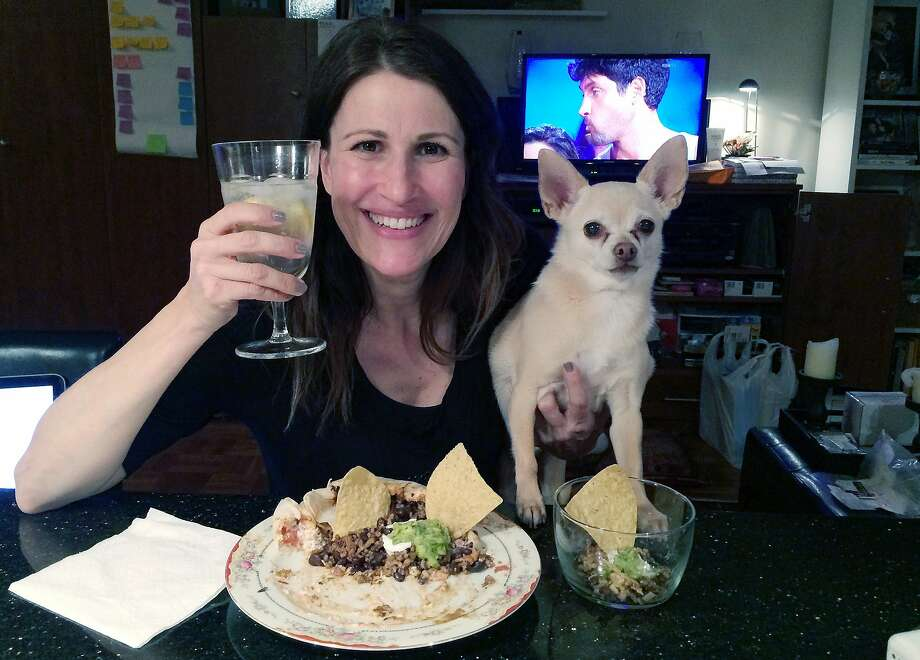 She warned him: When New Yorker Joanie Pelzer signed up with a dog-friendly online dating service a few years ago, she was honest about her 9-year-old Chihuahua Hubbell. She wrote that he likes people more than other dogs, craves attention, steals food and can't stand to ride in the backseat of a car. She found a man who loved animals as much as she did, but on their first date, Hubbell stole the man's breakfast as they drove from New York City to Long Island. They only had one more date. Photo: Dana Humphrey, Associated Press