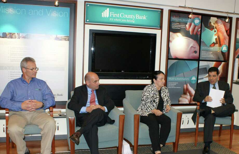 Panelists offered guidance to homebuyers during First County Bank's last Homebuyers Workshop in May. From left to right: Joe Lattarulo, home inspector at House Masters; Richard Margenot, attorney-at-law; Ruth Miner of Country Club Properties; Dave Zamary, senior vice president, residential originations at First County Bank.The next workshop is scheduled for Sept. 9 in Norwalk. Photo: Contributed Photo / Stamford Advocate Contributed