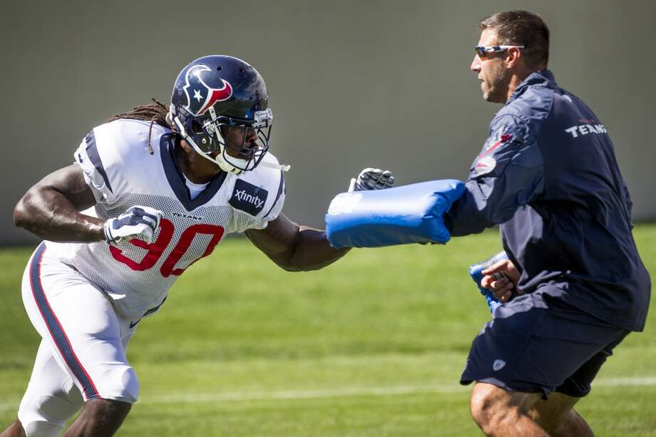 Day 17: August 20   Texans linebacker Jadeveon Clowney (90) runs a drill with linebackers coach Mike Vrabel during a joint practice with the Denver Broncos at the Broncos training facility on Wednesday in Englewood, Colo. Photo: Brett Coomer, Houston Chronicle