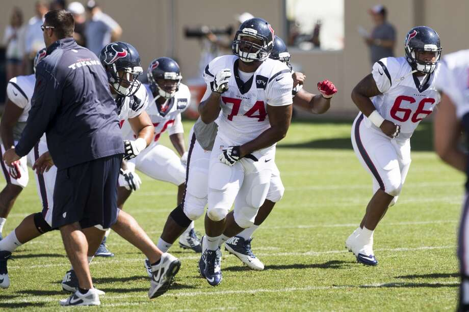 Texans defensive end Julius Warmsley (74) and nose tackle David Hunter (66) rush the passer during a drill. Photo: Brett Coomer, Houston Chronicle