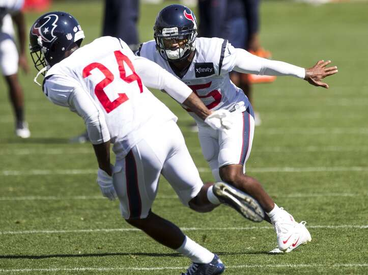 Texans cornerbacks Johnathan Joseph (24) and Kareem Jackson (25) run a coverage drill.