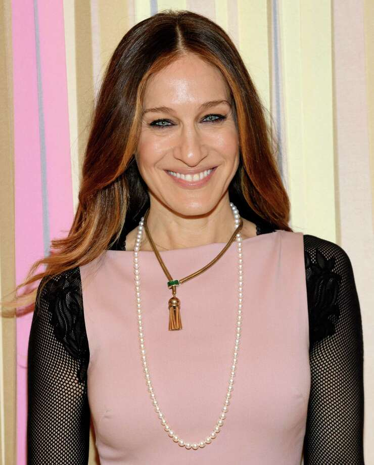 Actress and fashion designer Sarah Jessica Parker poses at the SJP Collection at Nordstrom pop up shop opening on Wednesday, Feb. 26, 2014 in New York. (Photo by Evan Agostini/Invision/AP) Photo: Evan Agostini, INVL / Invision