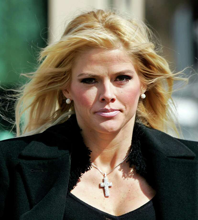 FILE - In this Feb. 28, 2006, file photo, Anna Nicole Smith, leaves the U.S. Supreme Court in Washington, D.C. Smith's final bid to obtain her late husband's money has failed, seven years after her death. A federal judge in Santa Ana, Calif., on Monday, Aug. 18, 2014, rejected a bid by Smith's estate to obtain about $44 million from the estate of J. Howard Marshall II, her late Texas billionaire husband. Photo: Manuel Balce Ceneta, AP / AP