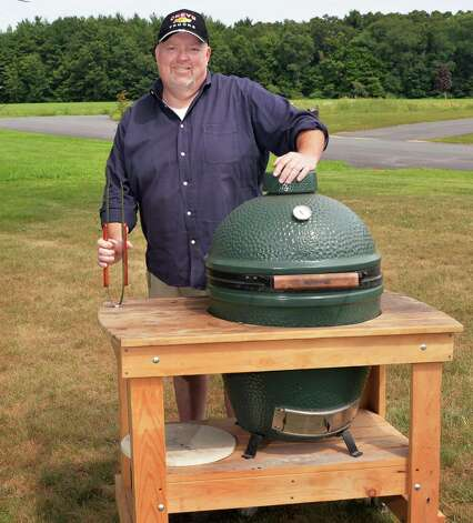 Rob Johnson poses with the Big Green Egg charcoal barbecue cooker he won last year at Grill Games Saturday August 16, 2014, in Castleton, NY.   (John Carl D'Annibale / Times Union) Photo: John Carl D'Annibale / 00028195A