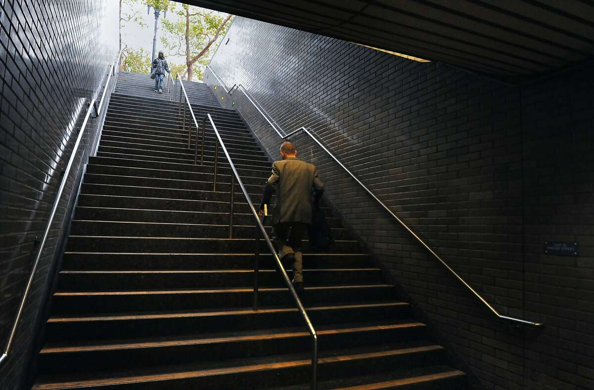 A commuter walks up the 1100 Market Street exit from inside the Civic Center BART station on August 20, 2014 in San Francisco, CA.