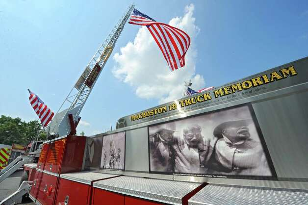 The MacBoston 18 Truck Fallen Firefighters Memorial is on display in the parking lot at the Desmond Hotel & Conference Center Wednesday, Aug. 20, 2014 in Colonie, N.Y. More than 1,000 volunteer firefighters and EMS personnel from around the state arel attending the 142nd Annual Convention of the Firemen's Association of the State of New York, or FASNY. (Lori Van Buren / Times Union) Photo: Lori Van Buren / 00028250A