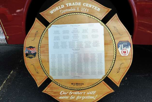 A World Trade Center plaque leans on the MacBoston 18 Truck Fallen Firefighters Memorial which is on display in the parking lot at the Desmond Hotel & Conference Center Wednesday, Aug. 20, 2014 in Colonie, N.Y. More than 1,000 volunteer firefighters and EMS personnel from around the state arel attending the 142nd Annual Convention of the Firemen's Association of the State of New York, or FASNY. (Lori Van Buren / Times Union) Photo: Lori Van Buren / 00028250A