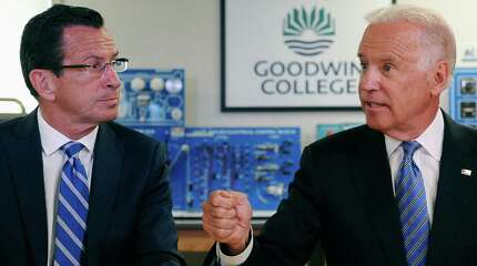 Vice President Joe Biden, right, gestures as he speaks as Connecticut Gov. Dannel P. Malloy, left, looks on, during a roundtable on workforce development at Goodwin College, Wednesday, Aug. 20, 2014, in East Hartford, Conn.