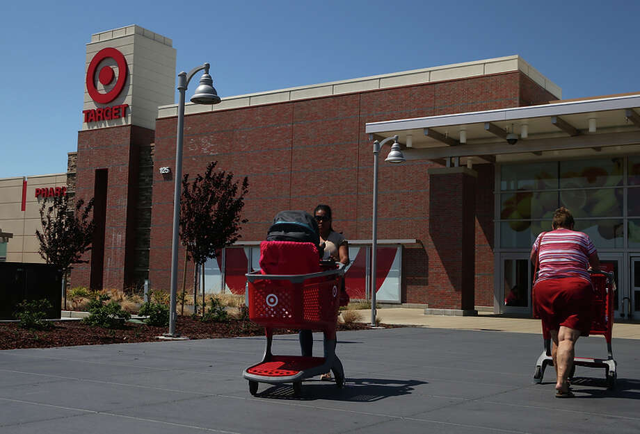 Customers leave a Target store last year in San Rafael. Marin County spearheaded the lawsuit. Photo: Justin Sullivan / Getty Images / 2014 Getty Images