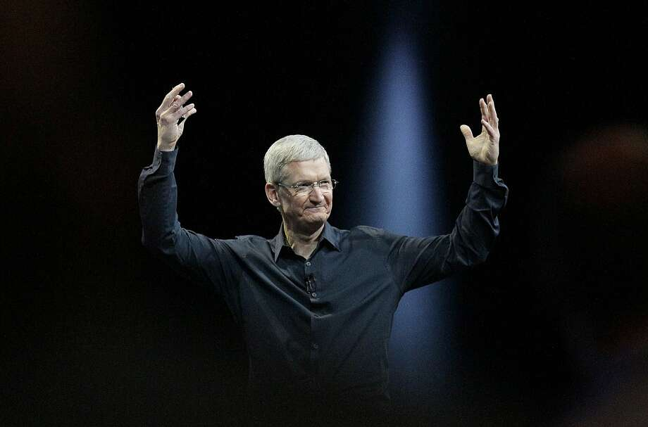 Apple CEO Tim Cook, here at the developers conference in June, is winning investors' confidence. Photo: Jeff Chiu, Associated Press