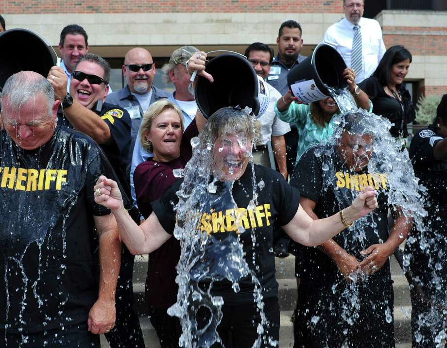 Bexar County Sheriff Susan Pamerleau, middle, and her leadership team have iced water poured over their heads as part of the internet sensation ALS Bucket Challenge fundraising event at the Bexar County Adult Detention Center on Wednesday, Aug. 20, 2014. Photo: Billy Calzada, San Antonio Express-News / San Antonio Express-News