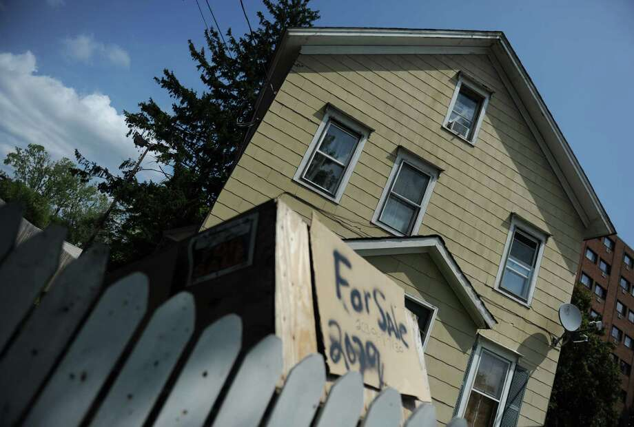 A blighted home on Main Street in Danbury, Conn. Wednesday, Aug. 20, 2014.  The city is increasing the powers of a blight-fighting crew to enforce rules against abandoned properties. Photo: Tyler Sizemore / The News-Times