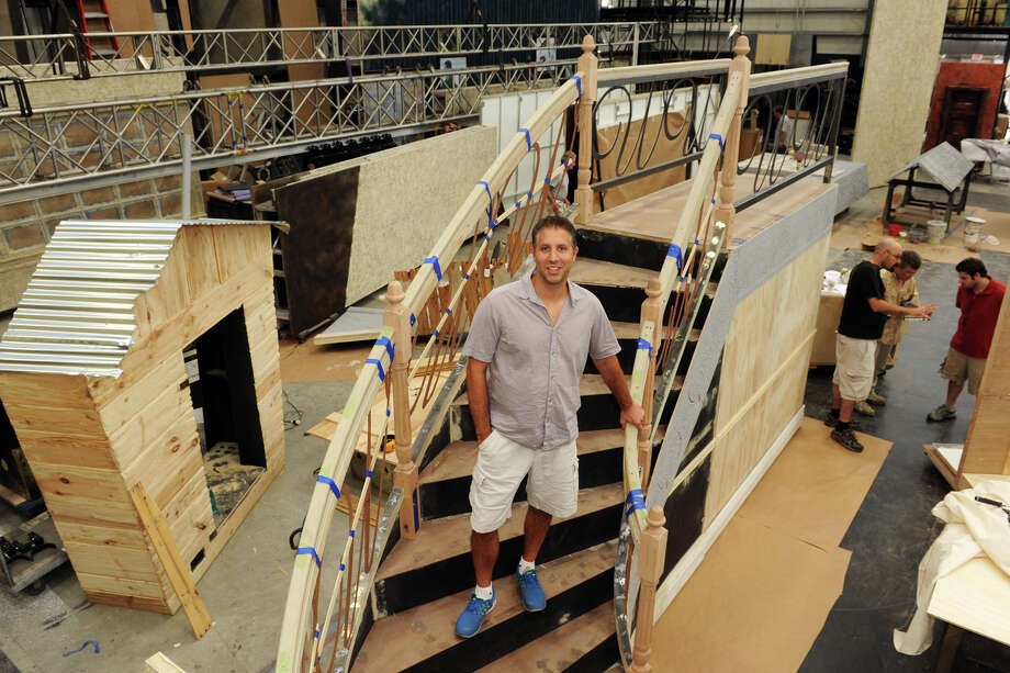 "Warren Katz, owner and founder of Global Scenic Services, stands on a stairway that will become part of a stage set for a traveling production of ""Annie,"" in Bridgeport, Conn. Aug. 20, 2014. Global designs and builds a wide variety of custom sets for stage productions, movies and television. Photo: Ned Gerard / Connecticut Post"