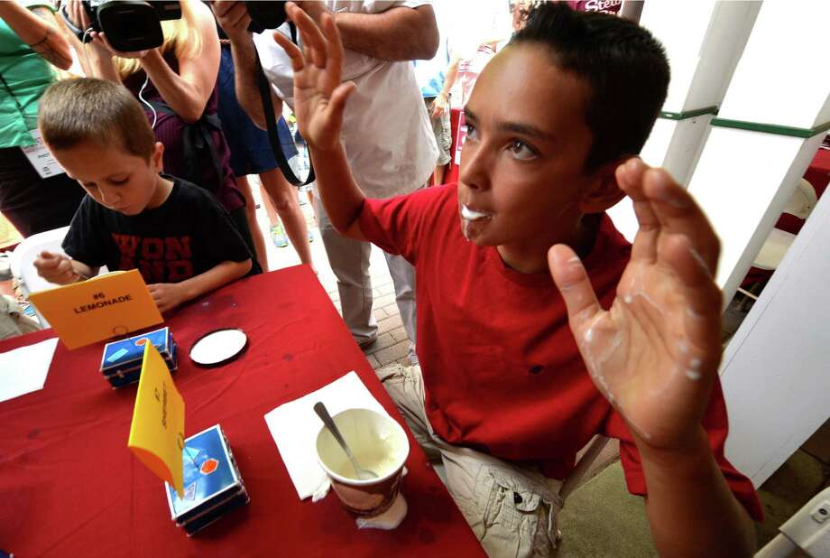 Thomas Krill, 12, of Ballston Lake wins the kids class of the Stewart's ice cream eating contest Wednesday afternoon Aug. 20, 2014,  at the Saratoga Race Course in Saratoga Springs, N.Y.    (Skip Dickstein/Times Union) Photo: SKIP DICKSTEIN