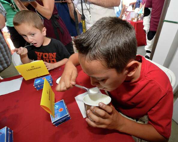 Thomas Krill, 12, of Ballston Lake uses his eating skills to win the kids class of the Stewart's ice cream eating contest Wednesday afternoon Aug. 20, 2014,  at the Saratoga Race Course in Saratoga Springs, N.Y.    (Skip Dickstein/Times Union) Photo: SKIP DICKSTEIN