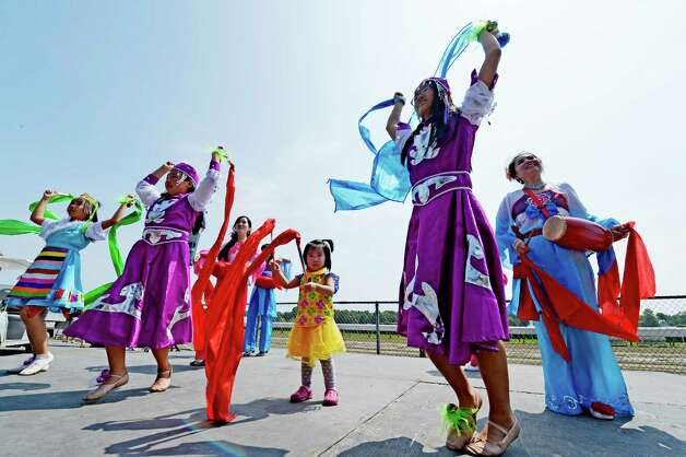 The Chinese Dance Troupe of Saratoga demonstrates traditional Chinese dance on Asian Heritage Day  Wednesday afternoon Aug. 20, 2014,  at the Saratoga Race Course in Saratoga Springs, N.Y.    (Skip Dickstein/Times Union) Photo: SKIP DICKSTEIN