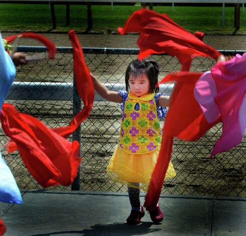 Claire Chang, 2, of the Chinese Dance Troupe of Saratoga takes part in a demonstration of traditional Chinese dance on Asian Heritage Day  Wednesday afternoon Aug. 20, 2014,  at the Saratoga Race Course in Saratoga Springs, N.Y.    (Skip Dickstein/Times Union) Photo: SKIP DICKSTEIN