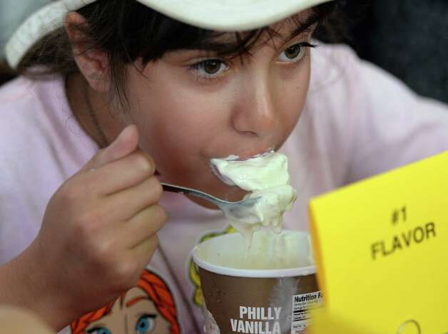 Angelina Angelone 11, of N. Providence R.I. participates in the Stewart's ice cream eating contest Wednesday afternoon Aug. 20, 2014,  at the Saratoga Race Course in Saratoga Springs, N.Y.    (Skip Dickstein/Times Union) Photo: SKIP DICKSTEIN