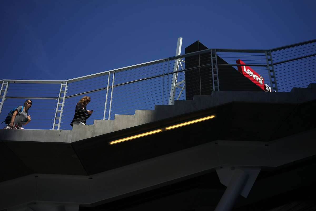 Visitors tour the new Levi's Stadium on Thursday, Aug. 14, 2014 in Santa Clara, Calif. Views of the mountain range as well as rooftop flowers contribute to the stadium's feng shui.
