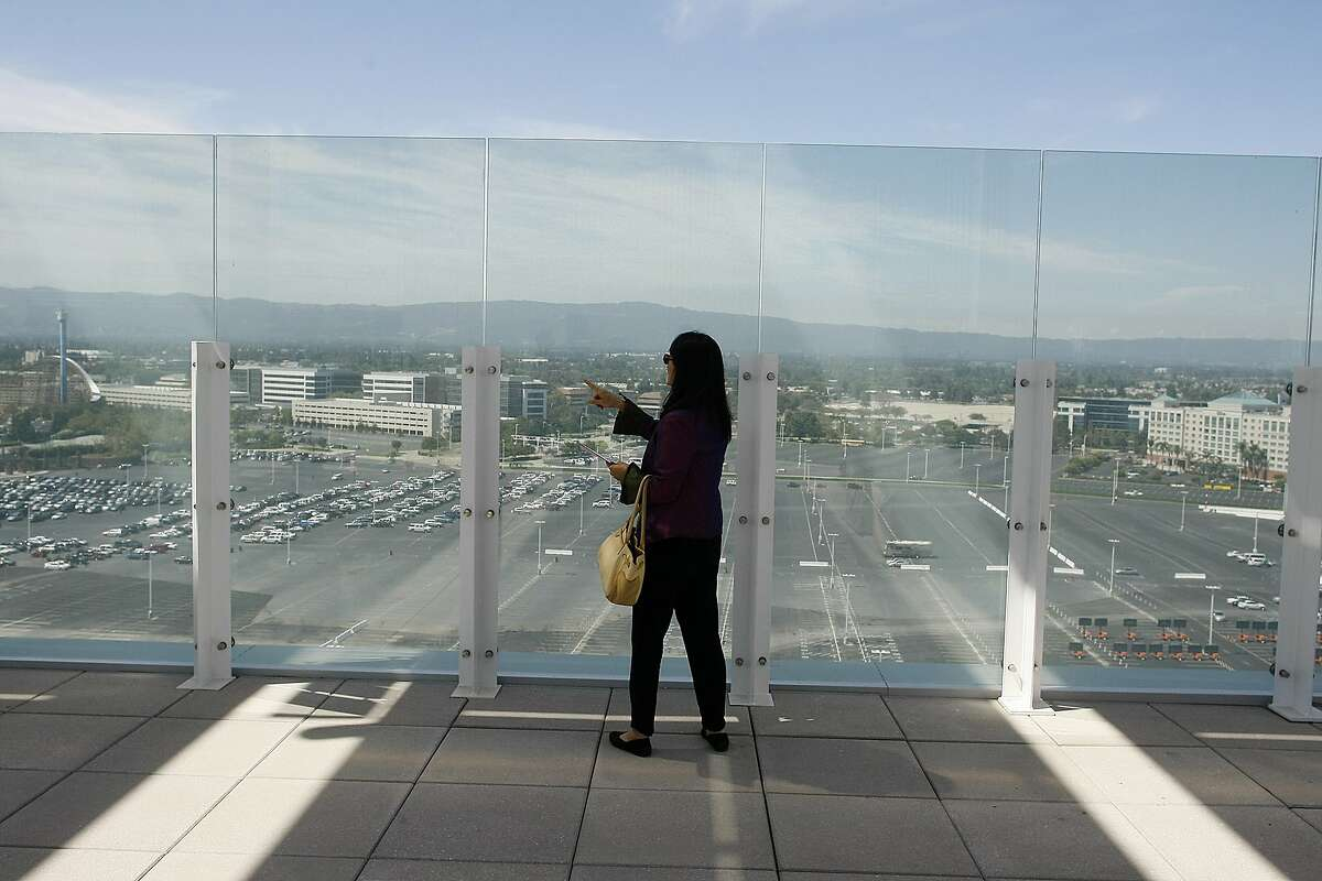 Feng shui expert Deborah Gee examines the view of the mountains from the Levi's Stadium on Thursday, Aug. 14, 2014 in Santa Clara, Calif. Views of the mountain range as well as rooftop flowers contribute to the stadium's feng shui.