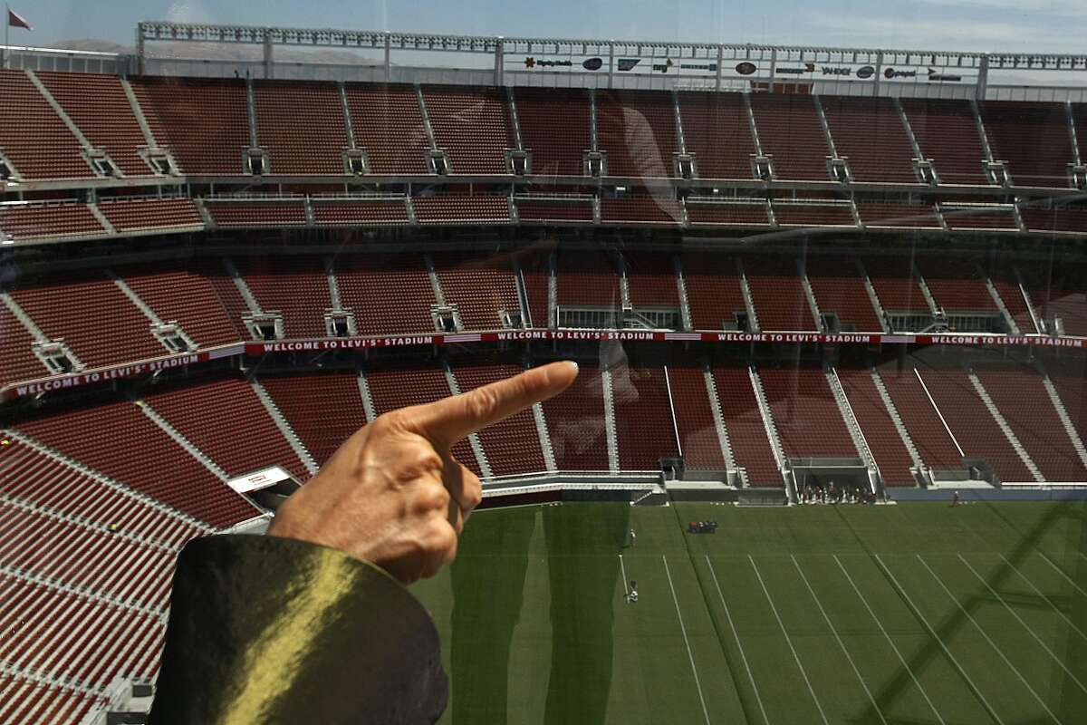 Deborah Gee examines the new Levi's Stadium as she evalutes its feng shui on Thursday, Aug. 14, 2014 in Santa Clara, Calif. Views of the mountain range as well as rooftop flowers contribute to the stadium's feng shui.