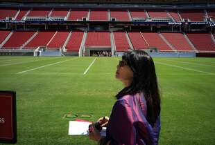 Feng shui expert Deborah Gee examines the new Levi's Stadium on Thursday, Aug. 14, 2014 in Santa Clara, Calif. Views of the mountain range as well as rooftop flowers contribute to the stadium's feng shui.
