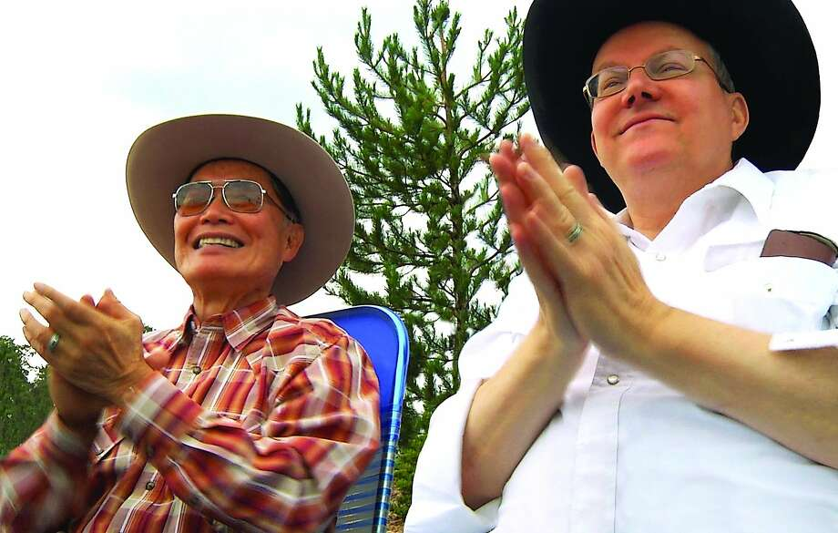 """George Takei (left), known for his role as Sulu on """"Star Trek,"""" watches a Fourth of July parade with husband Brad in Show Low, Ariz. The documentary """"To Be Takei"""" offers a glimpse into their relationship. Photo: To Be Takei/Chris Million, Courtesy"""