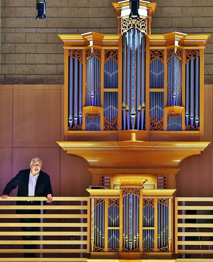 James David Christie stands next to the organ he'll play on Saturday. Photo: Will Bucquoy