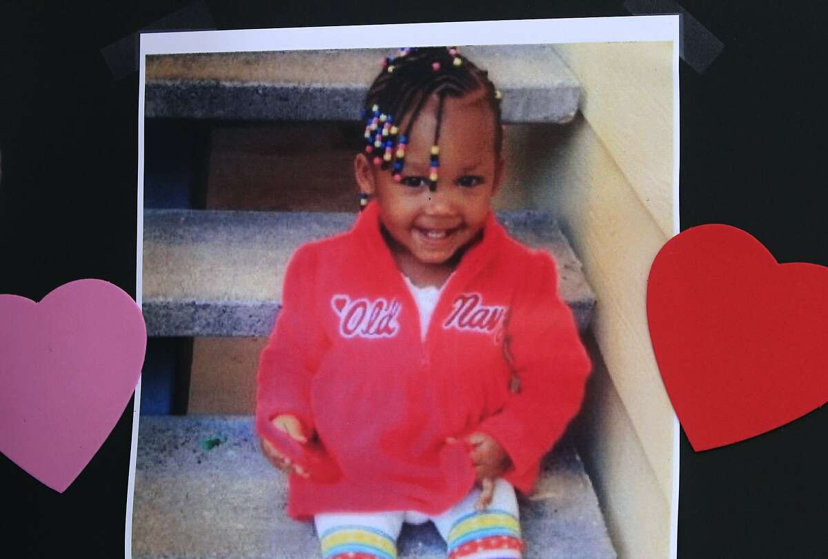 A family photograph of Mi'yana Gregory is part of a memorial for the two-year-old on Mission Street between Fourth and Fifth streets in San Francisco, Calif. on Wednesday, Aug. 20, 2014. Mi'yana was hit and killed by a hit and run driver as she was crossing the street in the crosswalk Saturday night. Police arrested Mi'yana's aunt for allegedly leaving the the girl in the street unattended, while the search for the driver continues.