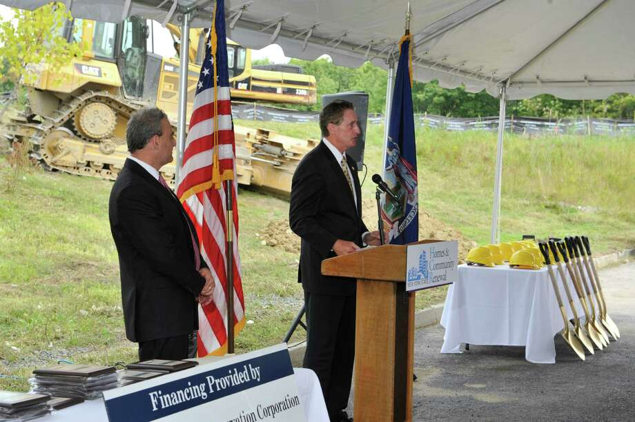 Larry Regan, left, president of Regan Development Corporation, listens as Lieutenant Governor Robert Duffy addresses those gathered for a groundbreaking event for the new Lion Heart Residences of Cohoes on Wednesday, Aug. 20, 2014, in Cohoes, N.Y.A  The housing will consist of 72 affordableA  units.A    (Paul Buckowski / Times Union) Photo: Paul Buckowski / 00028235A