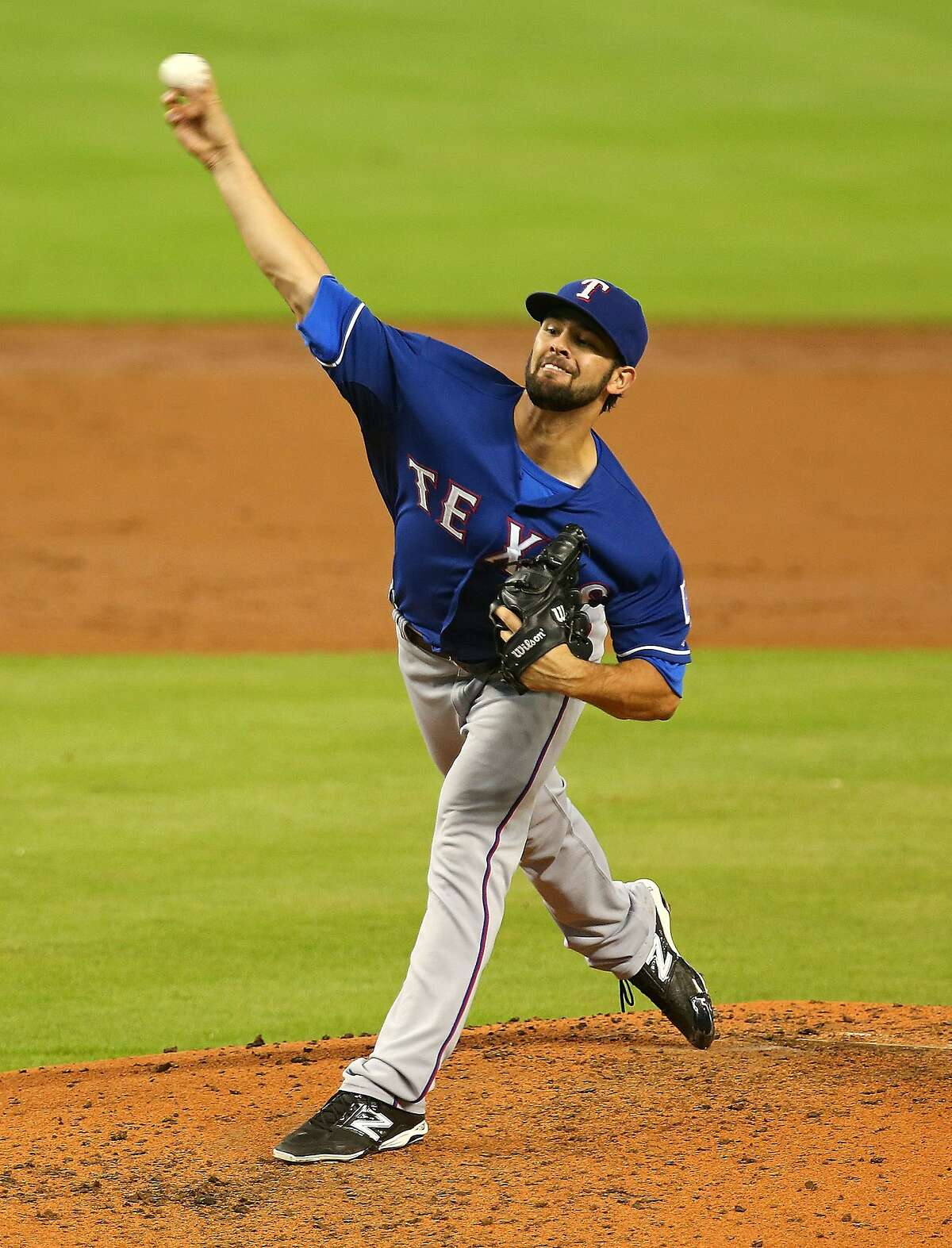 MIAMI, FL - AUGUST 20: Nick Martinez #22 of the Texas Rangers pitches during a game against the Miami Marlins at Marlins Park on August 20, 2014 in Miami, Florida. (Photo by Mike Ehrmann/Getty Images)
