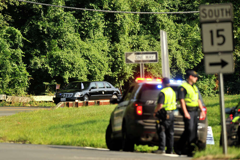 The motorcade carying Vice President Joe Biden and other Democratic officials travels north on North Street as police close off the exit ramp for the Merritt Parkway during Vice President Joe Biden's fundraising trip to Greenwich, Conn., on Wednesday, Aug. 20, 2014. Photo: Jason Rearick / Stamford Advocate