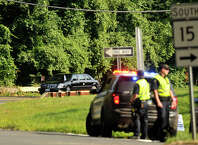 The motorcade carying Vice President Joe Biden and other Democratic officials travels north on North Street as police close off the exit ramp for the Merritt Parkway during Vice President Joe Biden's fundraising trip to Greenwich, Conn., on Wednesday, Aug. 20, 2014.