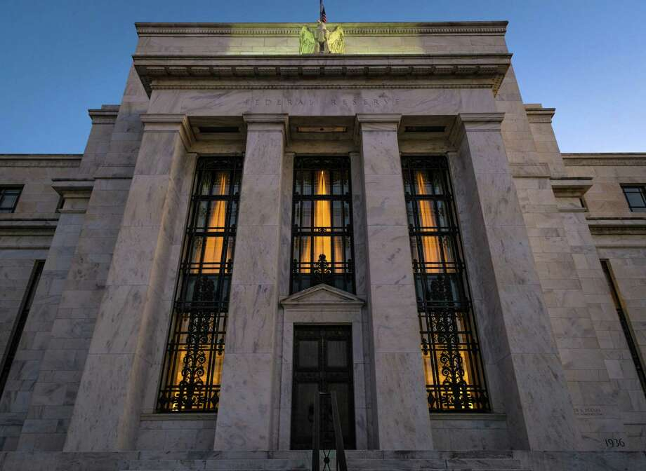 "FILE - This Sept. 18, 2013 file photo shows the Federal Reserve headquarters in Washington. Minutes of the Fed's discussion at its July 29-30, 2014 meeting show that some officials thought the economy was improving enough that the Fed would need ""to call for a relatively prompt move"" toward reducing the support it has been providing. Otherwise, they felt the Fed risked overshooting its targets for unemployment and inflation. (AP Photo/J. David Ake, File) Photo: J. David Ake, STF / AP"