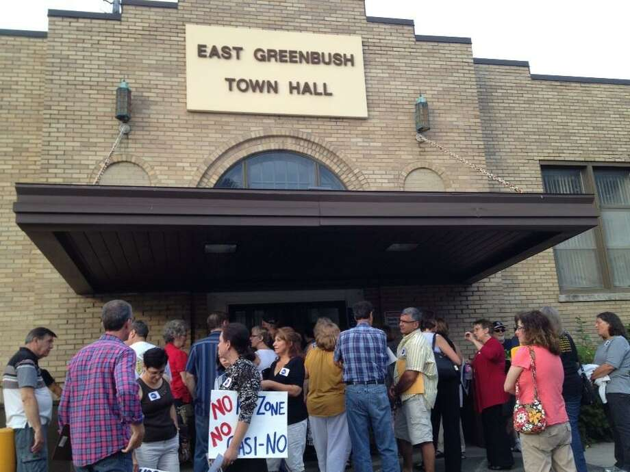 East Greenbush anti-casino forces gather in advance of Town Board casino vote Wednesday night Aug. 20, 2014. (Paul Grondahl / Times Union)