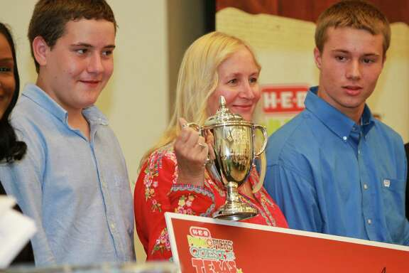 Grand prize winner Nanette Watson and her sons, Jordan Jensen, left, and Austin Jensen after the announcement of her win for Nanette Watson's Frio Farms, of Concan, Texas at the HEB Quest for Texas Best Finale. This is an annual contest sponsored by HEB to find the best Texas-made food products.  (For the Chronicle/Gary Fountain, August 20, 2014)