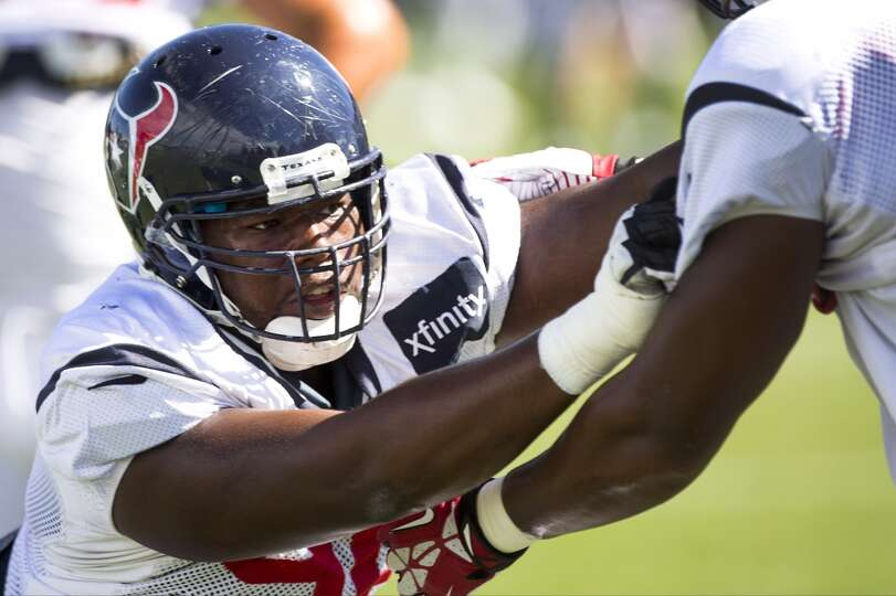 Texans defensive end Tim Jamison runs a pass rush drill.