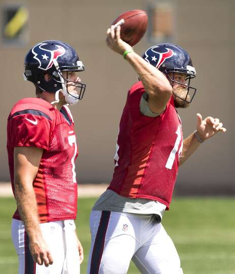 Texans quarterback Ryan Fitzpatrick (14) throws a pass with Case Keenum (7) looking on.