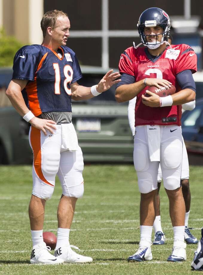 Broncos quarterback Peyton Manning (18) talks to Texans quarterback Tom Savage (3) following a joint practice. Photo: Brett Coomer, Houston Chronicle
