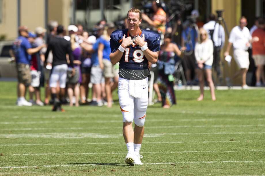 Broncos quarterback Peyton Manning (18) walks across the field following a joint practice. Photo: Brett Coomer, Houston Chronicle