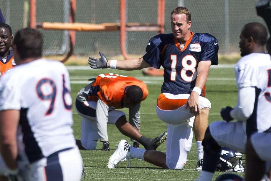 Broncos quarterback Peyton Manning (18) stretches. Photo: Brett Coomer, Houston Chronicle