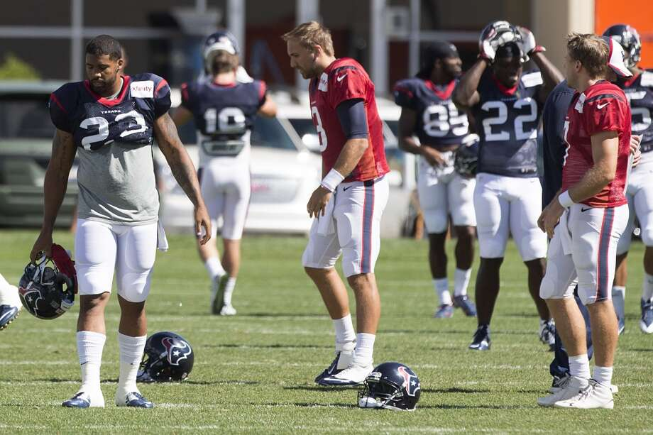 Texans running back Arian Foster (23), quarterback Tom Savage (3) and quarterback Case Keenum (7) get ready to stretch. Photo: Brett Coomer, Houston Chronicle