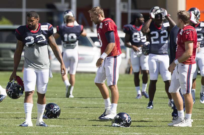 Texans running back Arian Foster (23), quarterback Tom Savage (3) and quarterback Case Keenum (7) ge