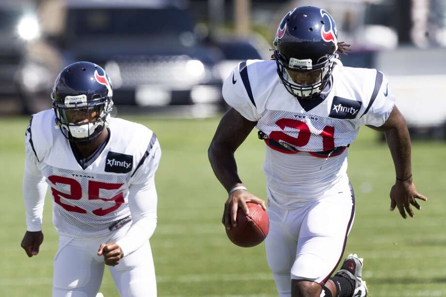 Texans cornerback Kareem Jackson (25) and free safety Kendrick Lewis (21) run an interception drill. Photo: Brett Coomer, Houston Chronicle
