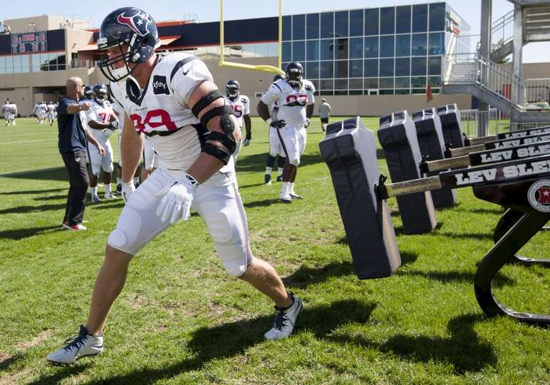 Texans defensive end J.J. Watt (99) runs a drill.