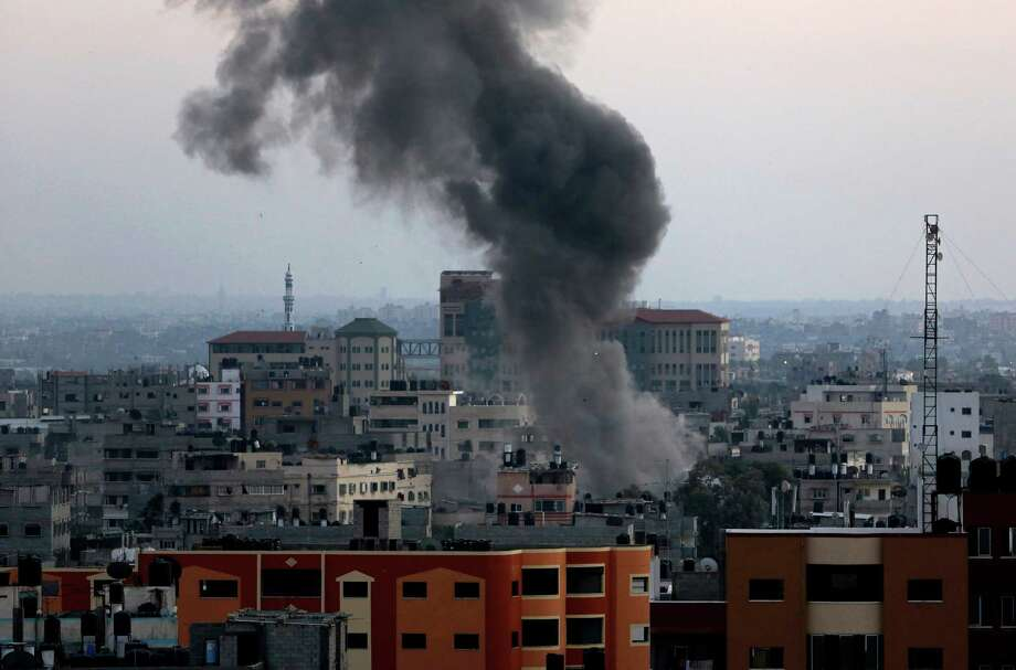 Smoke and dust rise after an Israeli strike hit Gaza City in the northern Gaza Strip, Wednesday, Aug. 20, 2014. (AP Photo/Adel Hana) Photo: Adel Hana, STF / AP
