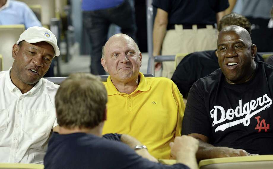Steven Ballmer (center) with former San Antonio Spur Doc Rivers, now the Clippers' coach, and NBA legend Magic Johnson. Photo: Kevork Djansezian / Getty Images / 2014 Getty Images