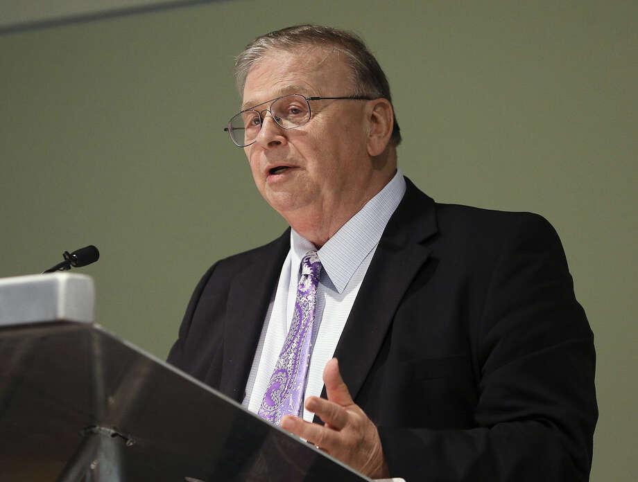 Bruce Miller, Port San Antonio's retiring CEO, speaks at the San Antonio Food Bank's event center. Photo: TOM REEL