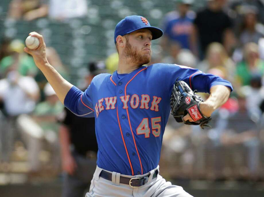 New York Mets starting pitcher Zack Wheeler throws in the first inning of their interleague baseball game against the Oakland Athletics Wednesday, Aug. 20, 2014, in Oakland, Calif. (AP Photo/Eric Risberg) ORG XMIT: OAS101 Photo: Eric Risberg / AP